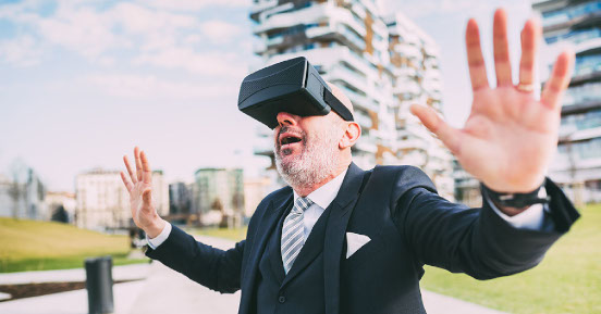 Man wearing a suit and VR headset