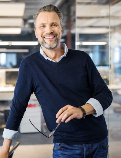 smiling man in office