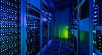 Picture of glowing light inside a data center.