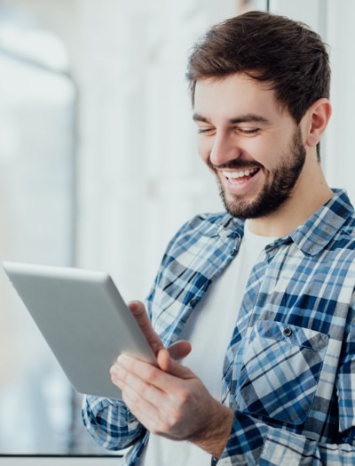 Smiling man holding a tablet